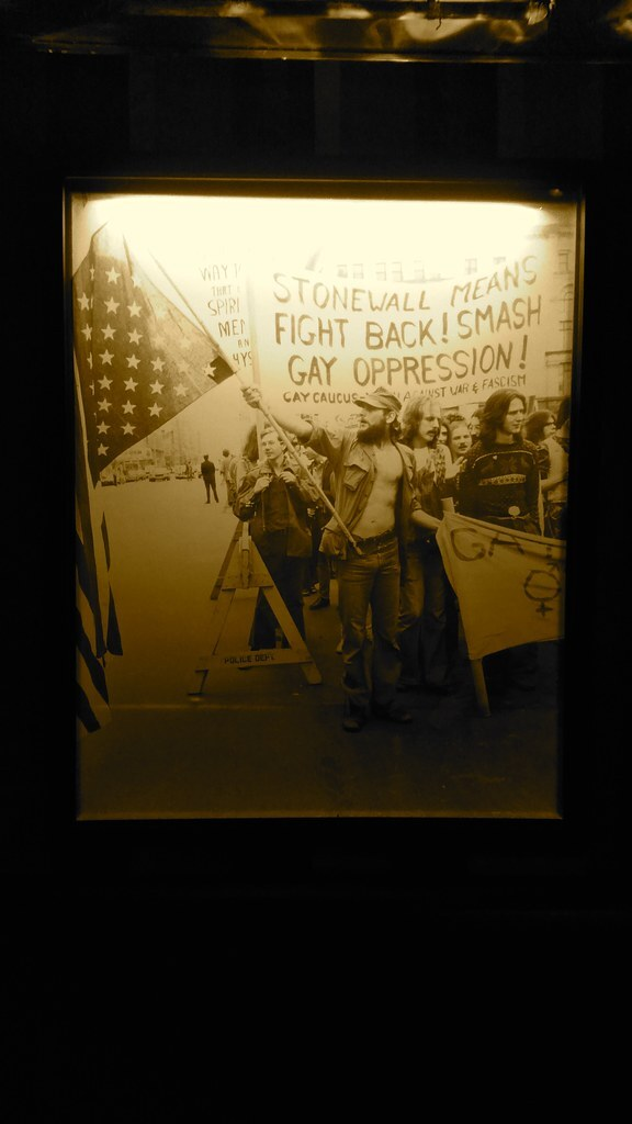 Framed photo of people marching against gay oppression