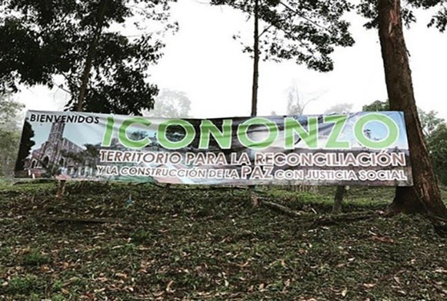 "The entrance to the FARC-EP demobilisation camp near Icononzo, Colombia. The sign reads: ""Territory for reconciliation through the constructions of peace with social justice"". © Chiara Mizzoni"""