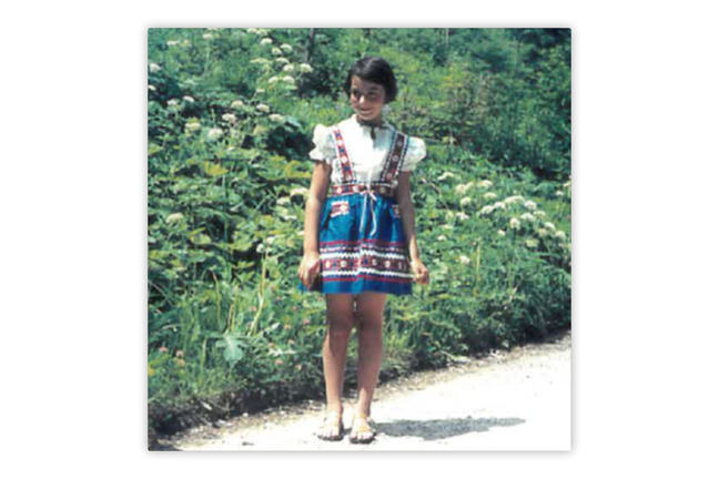 A photo of a girl in a colourful dress