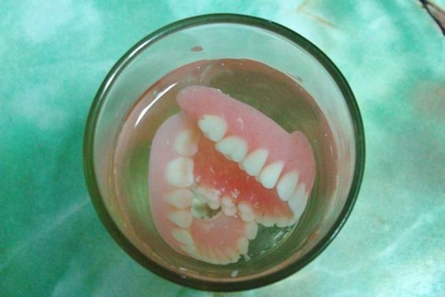 image of dentures soaking in water