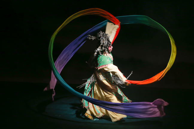 Actress dancing with rainbow coloured ribbon
