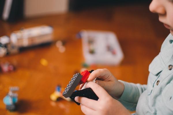 Boy playing Lego