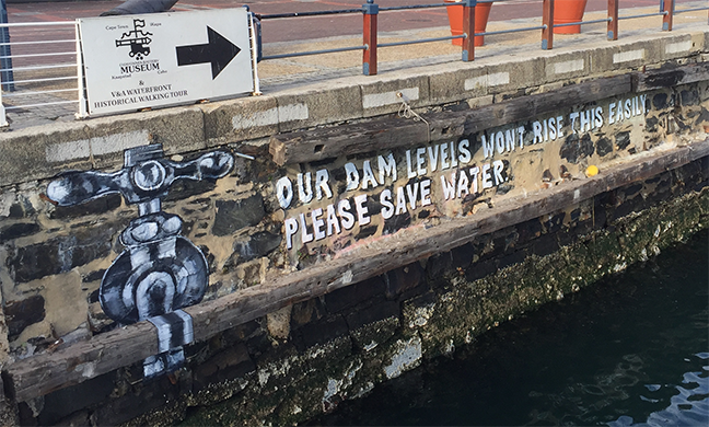 "Picture showing public art at V&A docks with the message ""Our dam levels won't rise this easily please save water"" and a picture of a tap"