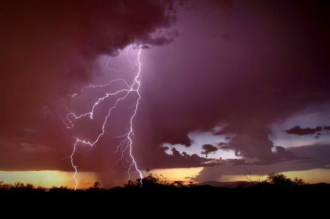 Photograph of a lightning strike just after sunset