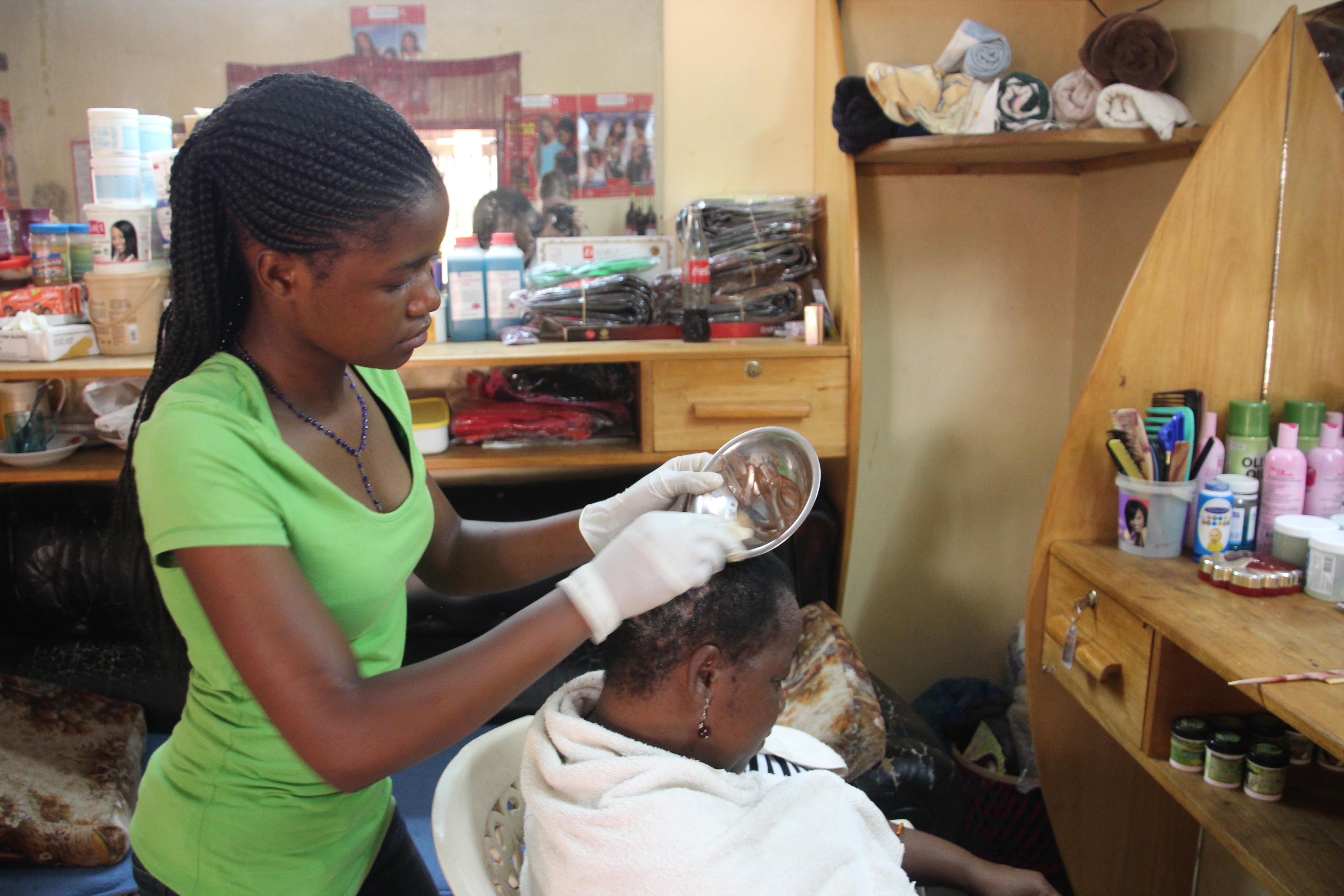 Hairdresser colour customers hair