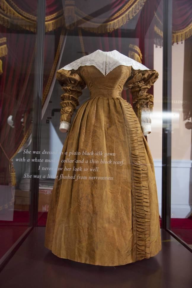 A brown dress within a display case