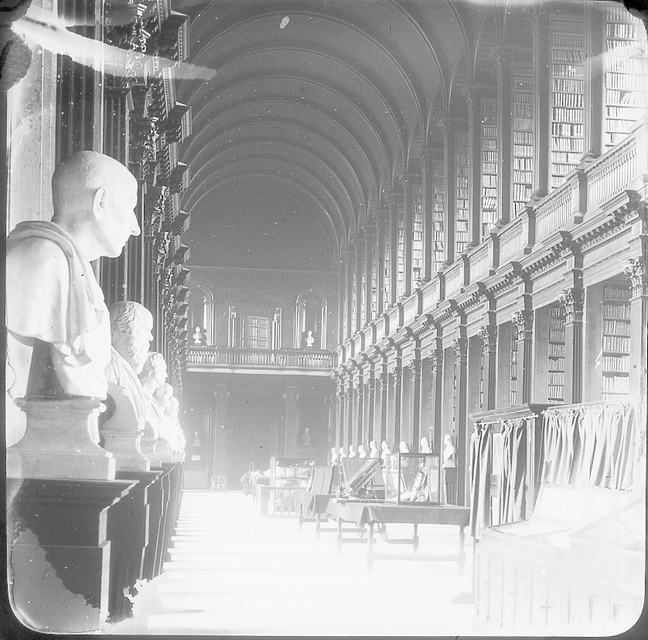 A black and white image of  The Long Room of Trinity Old Library at the end of the nineteenth century.