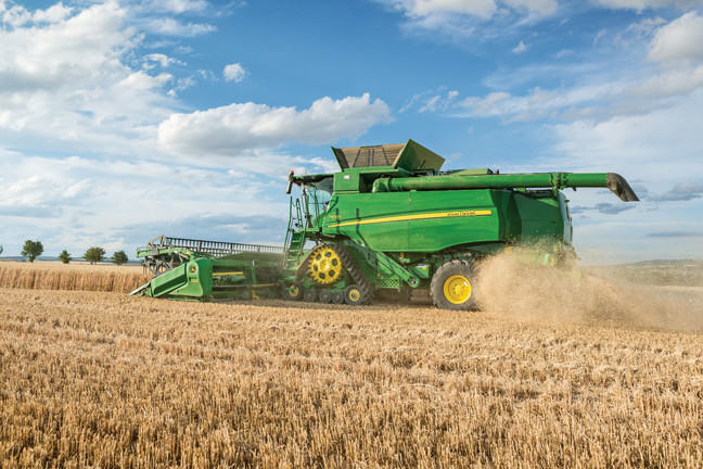 Combine harvester at work in the field