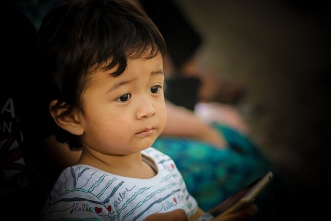 image of child looking drowsy and unhappy