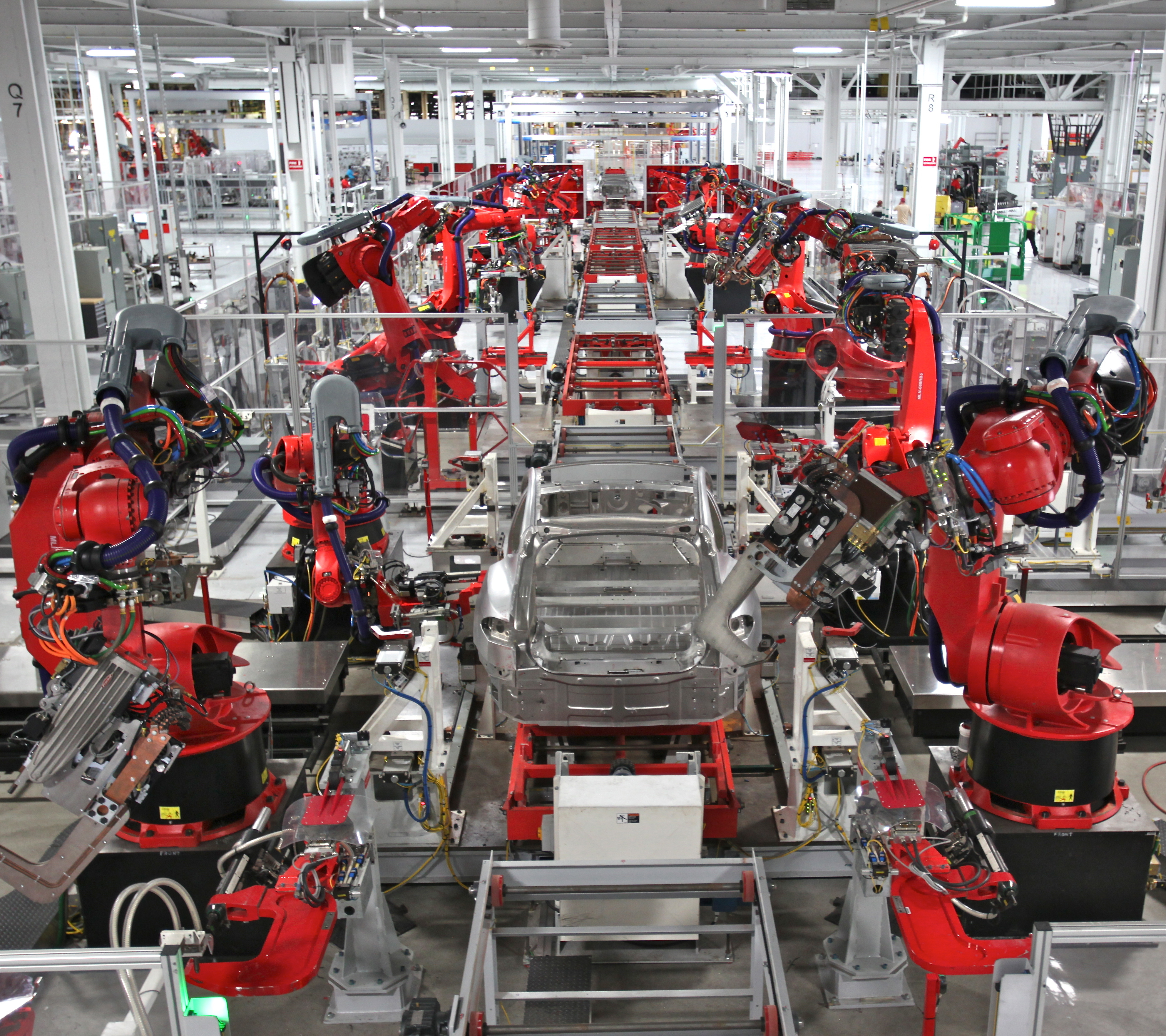 An automated production line in a car factory incorporating robot manipulators.