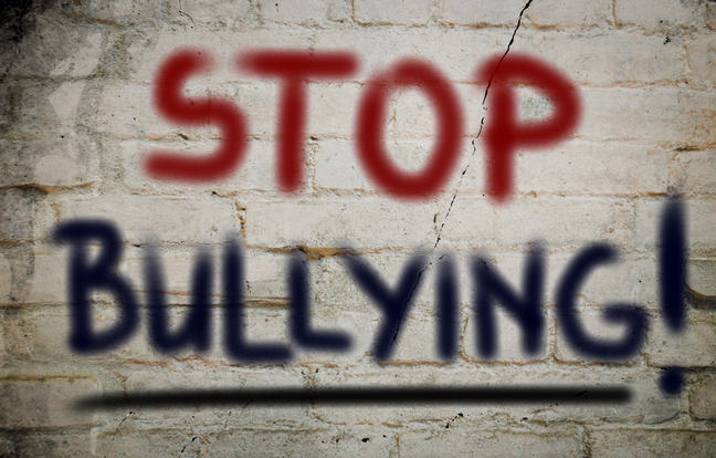 """Stop bullying"" written on a wall"