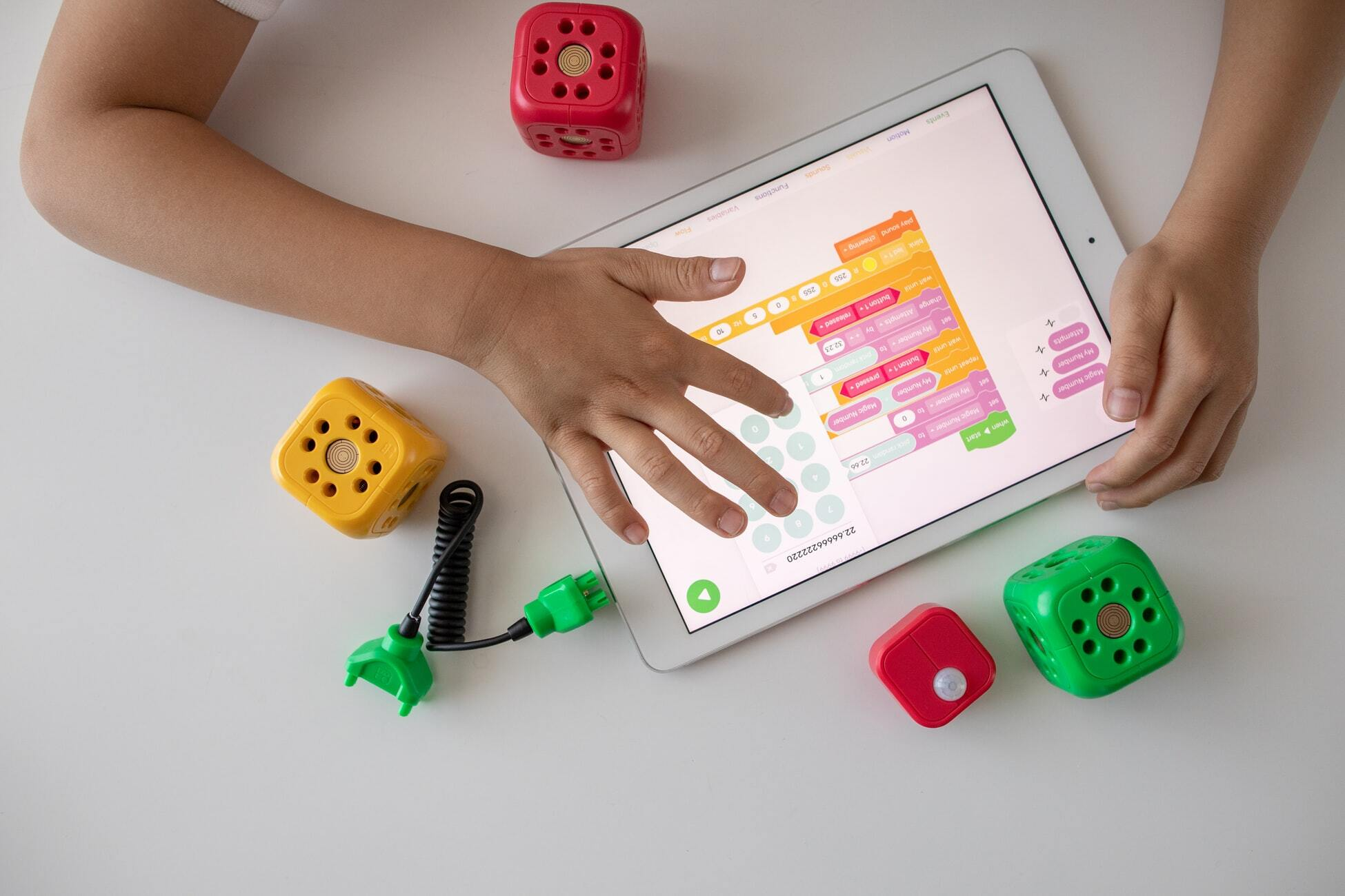 Person playing interactive game on a tablet device