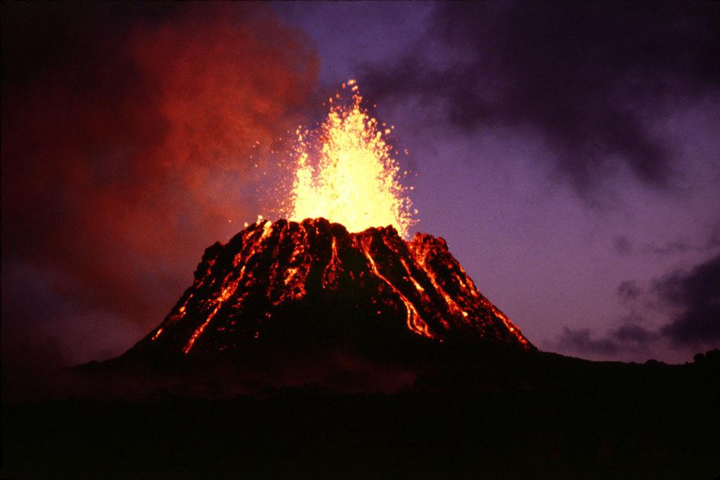 The Pu'u 'O'o volcanic cone on Kilauea, Hawaii experiencing an explosive eruption and spewing lava