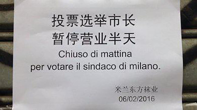 A sign with Chinese translated into Italian