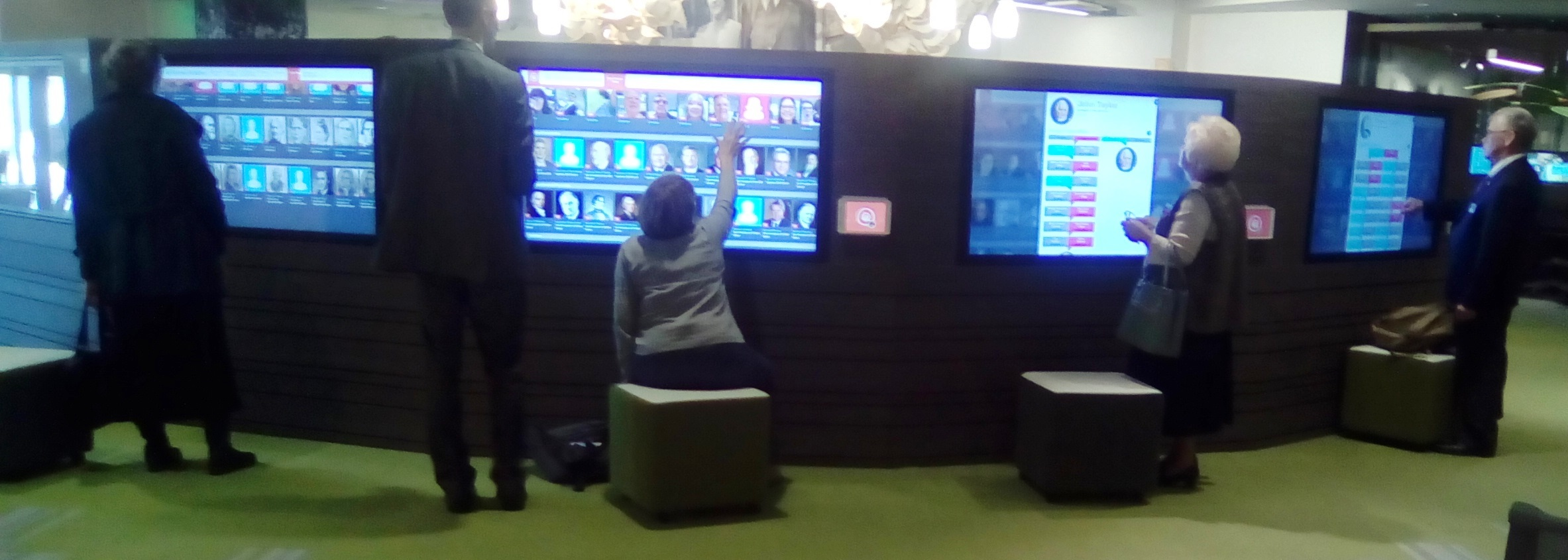 People interacting with touchscreens
