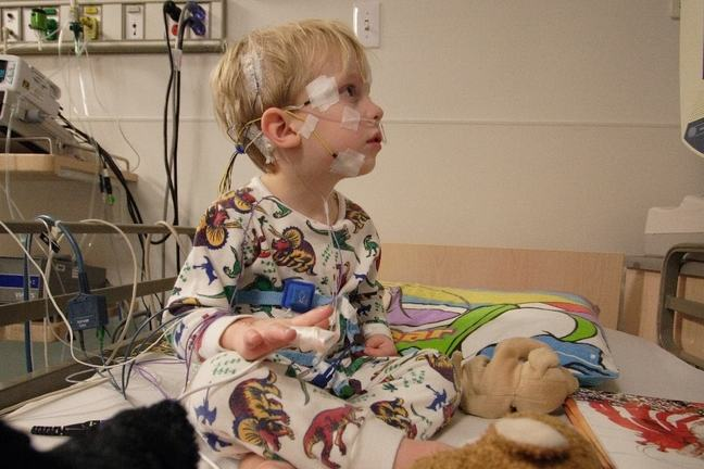 young boy hooked up to an electromyogram
