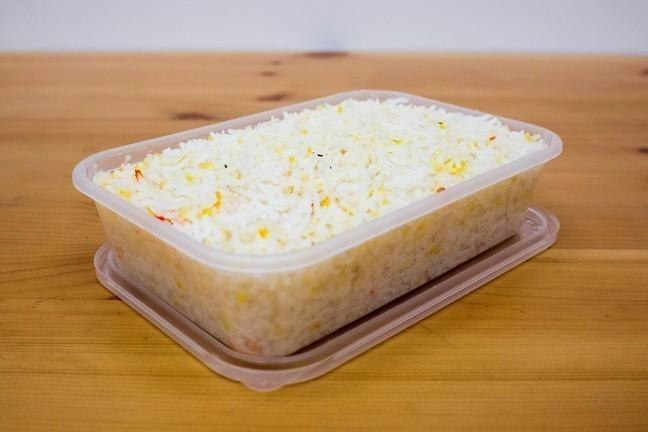 Photo of takeaway rice in plastic carton