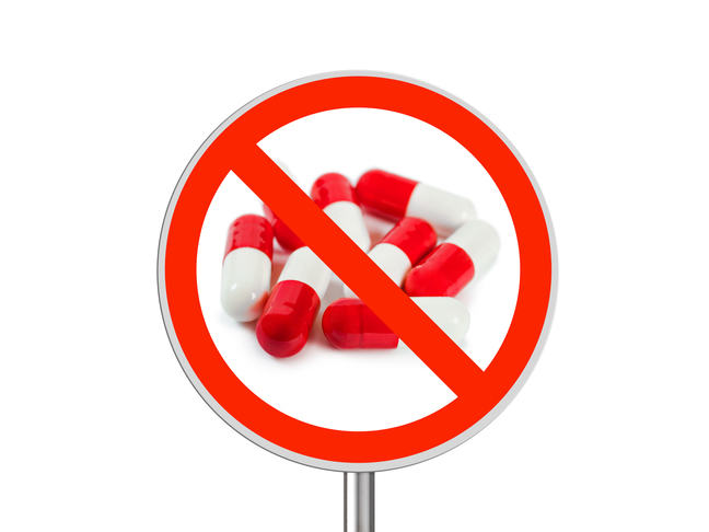 Pills with a warning sign