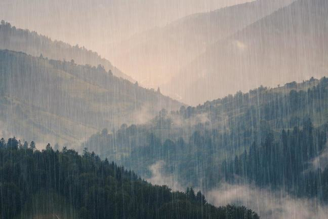 Photograph of some mountains in the rain
