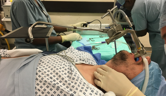 Suspension laryngoscope in position