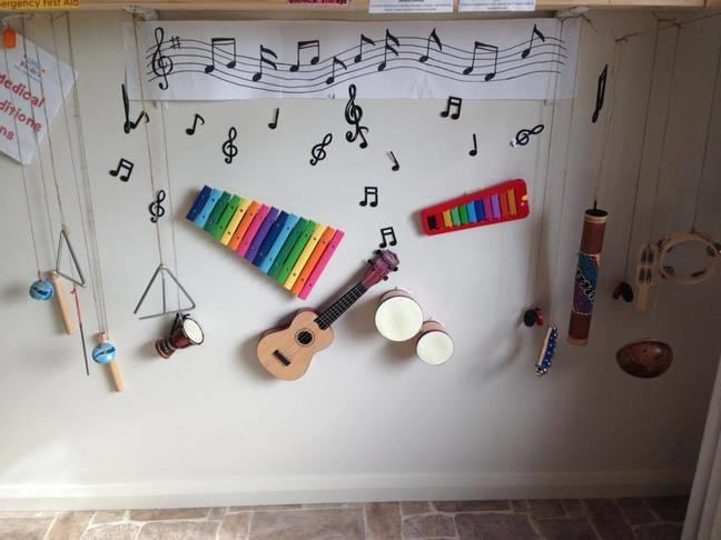 Photograph of a music wall of hanging instruments at an early childcare centre