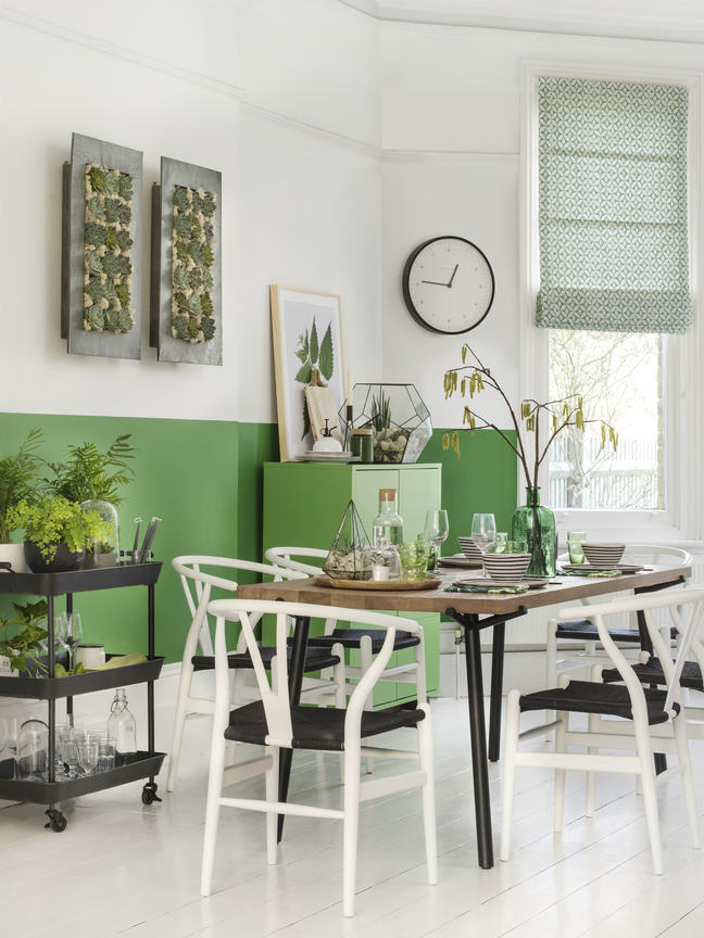 Emerald green paint used on the lower half of the walls of a room