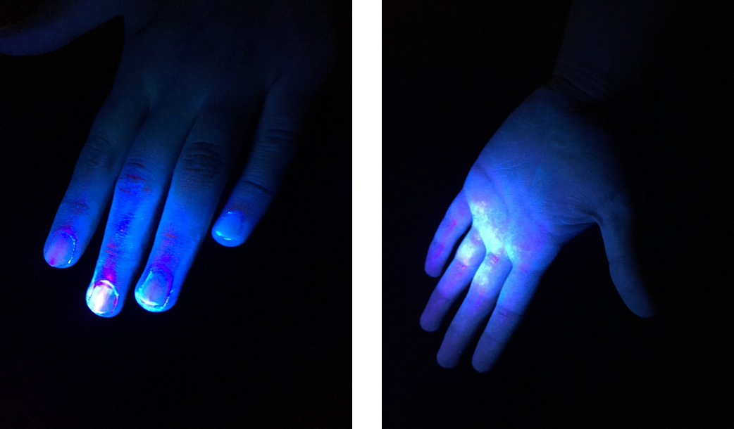 Photo of hands and hands with UV light shining on them