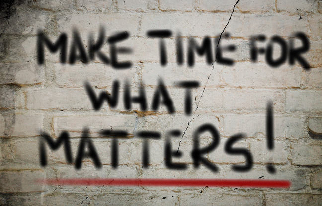 A wall with the words Make time for what matters! painted on