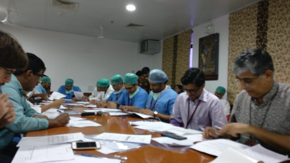 Image of medical professionals around a table