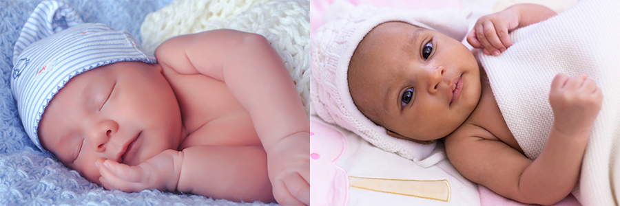 Two babies lay side by side. Caucasian baby is pictured left and the African-American baby is pictured right