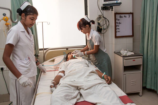 International Nurses assisting a Patient with breathing difficulties.