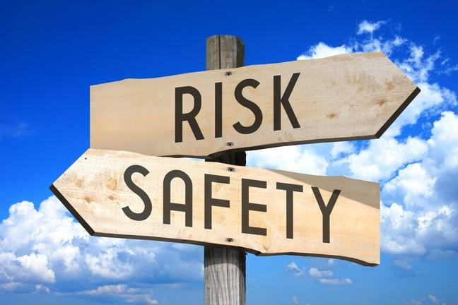 Signpost with Risk and Safety poinging in opposite directions.