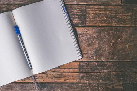 Ballpen on the blank notebook