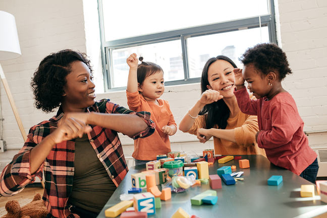 diverse children and teachers playing at pre school