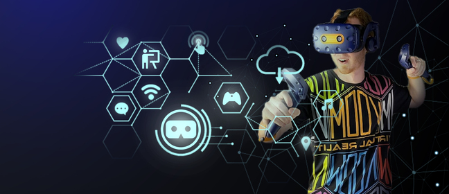 Image of men with VR head set on and different icons in front of him