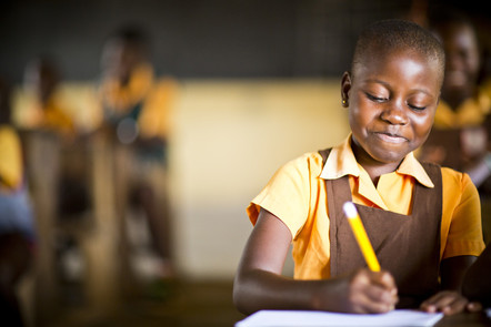 A school student in Ghana writing.