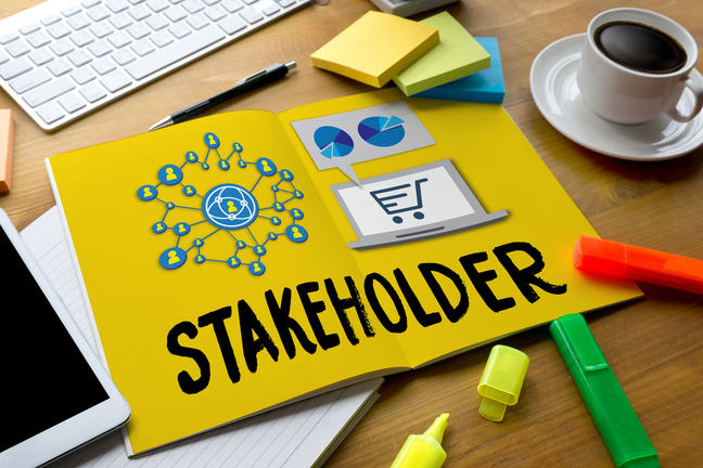"Image of an open book on a desk with the words ""Stakeholder"""