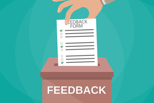 A hand putting a feedback form into a box labelled feedback.