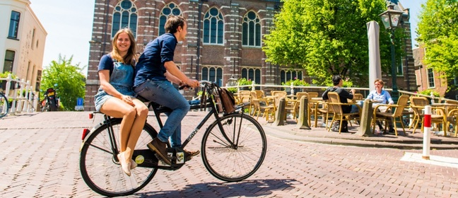 Students cycling on campus