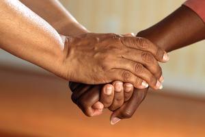 Welcoming handshake between two people