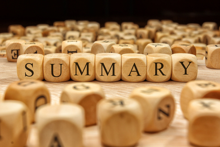 Wooden blocks with the letters of the word summary written on them