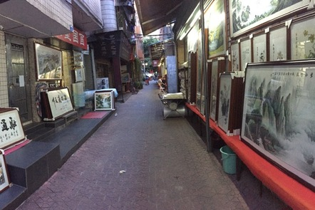 A small street with paintings and calligraphies