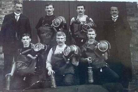 Mine rescue unit, male miners posed with their equipment
