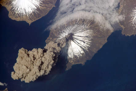 Astronauts photo from high in the atmosphere of ash cloud spewing out and spreading from Mount Cleveland, Alaska, USA.