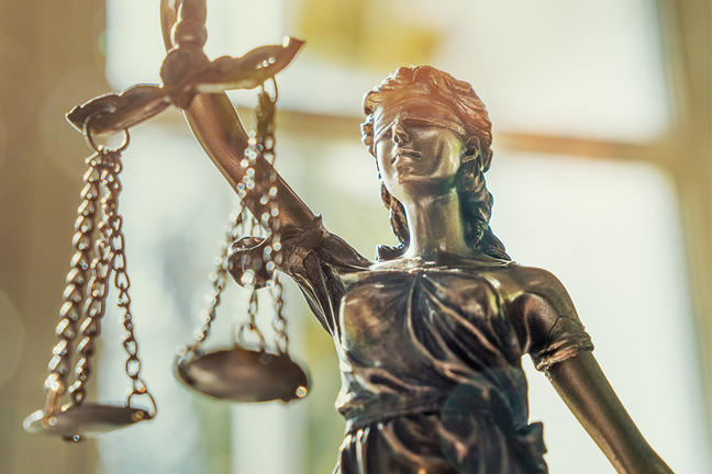 Close up of the statue of blind justice.