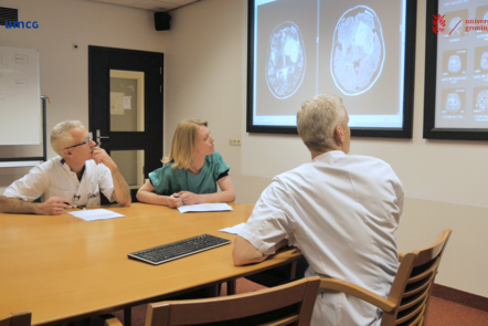 The clinicians investigating brain scans