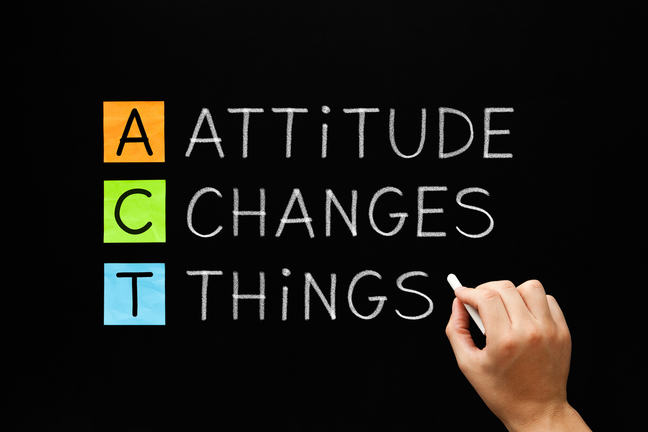 This image has three words written in chalk on a board in a vertical list. The words are: attitude changes things. To the left hand of each word is the first letter, creating a vertical list ACT