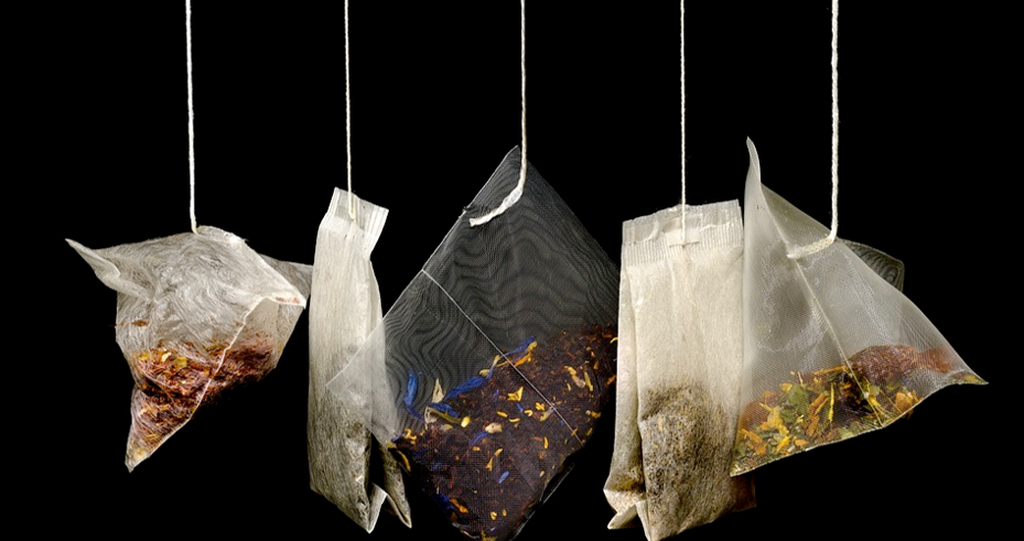 A row of a selection of teabags hanging down.