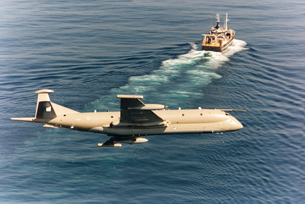 A Nimrod on patrol over the sea, with an unknown ship in the background.