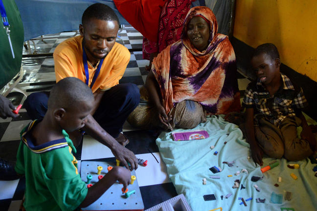Rehabilitation and occupational therapy exercises for children with disabilities in rehabilitation center in Kakuma, with the support of Handicap International, Kenya, June 2015